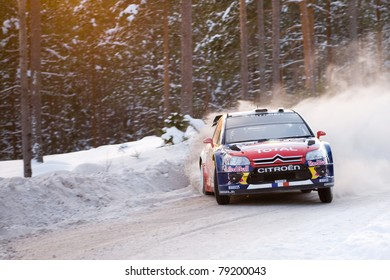 HAGFORS, SWEDEN - FEB 13: Sebastien Loeb drifting with his Citroen WRC car during the event Rally Sweden 2010, in Hagfors, Sweden on February 13, 2010