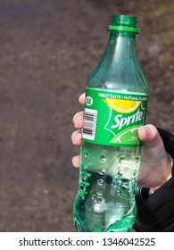 Hagfors, Sweden March 21, 2019. A child holding a bottle of Sprite in her hand.