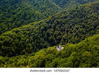Haghartsin Monastery in Caucasus mountains. Old Armenian church from aerial view. Orthodox church in forest valley. Nature landscape. Dilijan, Armenia