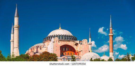 Hagia Sophia (Holy Wisdom) Ottoman imperial mosque and now a museum (Ayasofya Müzesi) in Istanbul, Turkey. Blue sky with clouds in background.