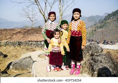 Hagiang, Vietnam - Feb 14, 2016: Portrait of H'mong little girls wearing traditional dress during Lunar New Year holiday in Dong Van district.