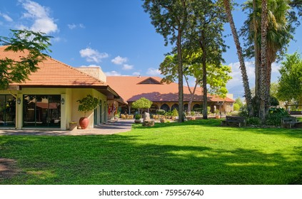 HAGOSHRIM, ISRAEL - SEPTEMBER 14, 2014: Landscape with main building of hotel of kibbutz HaGoshrim, located in northern part of Israel.
