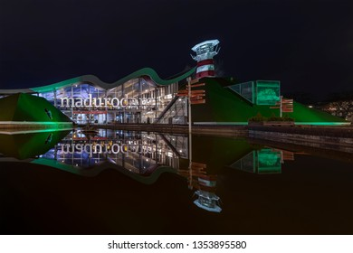 THE HAGUE, 27 March 2019 - Front view of Madurodam miniature, the  park that shows most of the Dutch monuments under a clear water at night, Netherlands