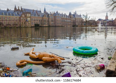 The Hague binnenhof lake, the Netherlands - March 11 2018: plastic pollution washed ashore in the lake of the Dutch parliament in The Hague