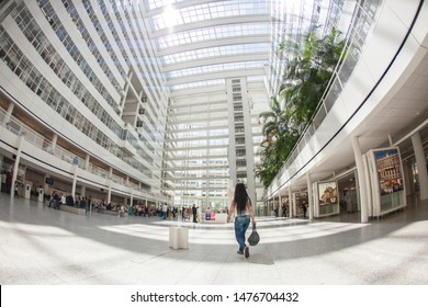 The Hague/ Den Haag, Netherlands - June 02 2009 : The city hall and his atrium. A building all white with sun coming through the glass roof contruction by jeff koon