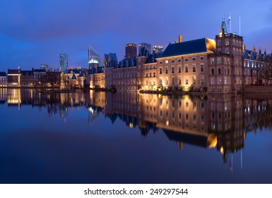The Hague (Den Haag) Skyline with Binnenhof Palace, Mauritshuis Museum, and modern skyscrapers at night, The Netherlands.