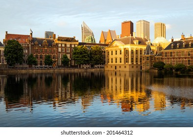 The Hague (Den Haag) Skyline with Mauritshuis Museum, Binnenhof Palace, and modern skyscrapers at sunset, The Netherlands.
