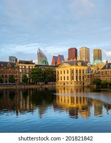 The Hague (Den Haag) skyline with Mauritshuis Museum, Het Torentje, and modern skyscrapers reflected in the Hofvijver canal, The Netherlands.