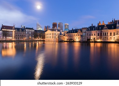 The Hague (Den Haag) skyline with Mauritshuis Museum, Binnenhof palace (Dutch Parliament), and modern skyscrapers reflected in the Hofvijver canal, The Netherlands.