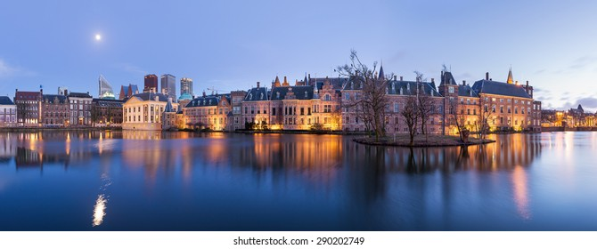 The Hague (Den Haag) skyline panorama with Mauritshuis Museum, Binnenhof palace (Dutch Parliament), and modern skyscrapers reflected in the Hofvijver canal at twilight, The Netherlands.