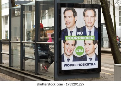 """The hague, Holland - March 10, 2021: Billboard D66 elections. The text says """"NU DOORPAKKEN"""". English translation is """"Now get on with it"""""""