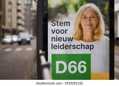 """The hague, Holland - March 10, 2021: Billboard D66 elections. The text says """"Stem voor nieuw leiderschap D66"""". English translation is """"Vote for new leadership D66"""""""