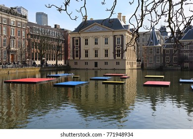 The Hague, Holland - March 12, 2017: Colored plates in the Hofvijver pond at the Mauritshuis museum to celebrate the 100th birthday of the painter Mondrian in The Hague, Holland on March 12, 2017