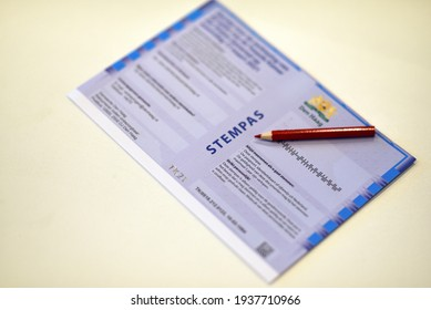 The hague, Holland - March 17, 2021: Voting pass for the general elections of March 2021 in the Netherlands with a red pencil.