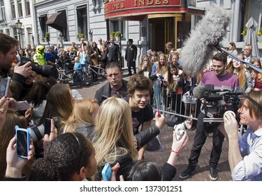 THE HAGUE, HOLLAND - MAY 3: Harry Styles of the boy band One Direction leaves Hotel des Indes among a crowd of teenage fans in The Hague, Holland on May 3, 2013