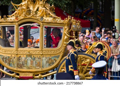 THE HAGUE, HOLLAND - SEPT 16: Queen Maxima waving in golden carriage waving to crowds on the bicentennial Prinsjesdag (opening parliamentary year by King) on September 16, 2014 in The Hague, Holland.