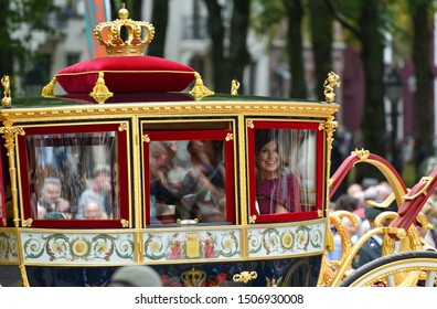 THE HAGUE, HOLLAND - SEPTEMBER 17, 2019: The Glass Coach with Queen Maxima and King Willem-Alexander waving to the crowds on Prinsjesdag on September 17, 2019 in The Hague, Holland.