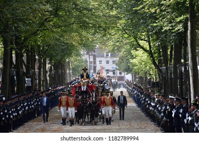 THE HAGUE, HOLLAND - SEPTEMBER 18, 2018: The golden carriage with Queen Maxima and King Willem-Alexander waving to the crowds on Prinsjesdag on September 18, 2018 in The Hague, Holland.