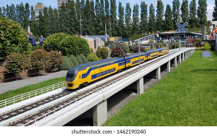 The Hague - July 16, 2019: Madurodam open air museum is located at the George Maduroplein in Den Haag and showcases The Netherlands in miniature. In this image a train from the Nederlandse Spoorwegen.