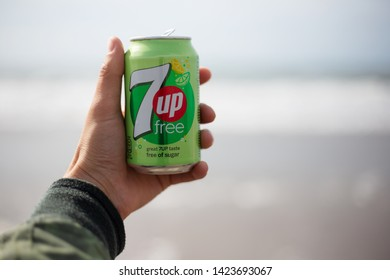 The Hague, Netherlands - 09.06.2019: Young man holding a bank of new 7up free.