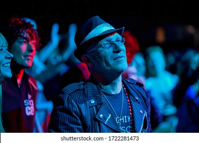 The Hague, Netherlands - 21 May 2009 : a senior citizen old rocker in the crowd during a music concert with a hat on