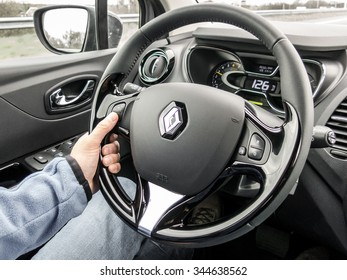 THE HAGUE, NETHERLANDS - APR 22, 2015: Driver using cruise control at steering wheel while driving a car