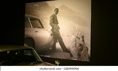 THE HAGUE, THE NETHERLANDS – APRIL 21, 2019: A picture of Sean Connery, near the famous and genuine Aston Martin from James Bond, 007 within the Louwman Museum