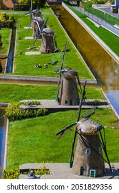 The Hague, Netherlands - April 26, 2017: Windmills in Madurodam miniature park in The Hague.