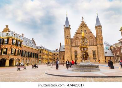 Hague, Netherlands - April 5, 2016: People near Binnenhof palace, place of dutch parliament in Hague or Den Haag, Holland, Netherlands