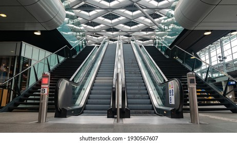 The Hague, The Netherlands - August 18, 2019 - Symmetrical Escalator At Railway Station at The Hague