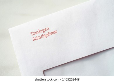 The Hague, The Netherlands - August 22, 2019: Envelope from the Dutch tax authorities (In Dutch: De Belastingdienst) regarding allowances (In Dutch: Toeslagen)