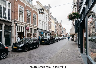 The Hague, The Netherlands - August 7, 2016: View of typical commercial street in the Hague  a cloudy day of summer.