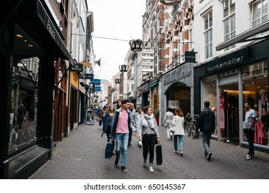 The Hague, The Netherlands - August 7, 2016: Unidentified  people in Hoogstraat  a commercial street in the city centre of the Hague. The Hague is the seat of the Dutch government.