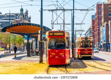 THE HAGUE, NETHERLANDS, AUGUST 7, 2018: Typical red trams in the center of the Hague, Netherlands