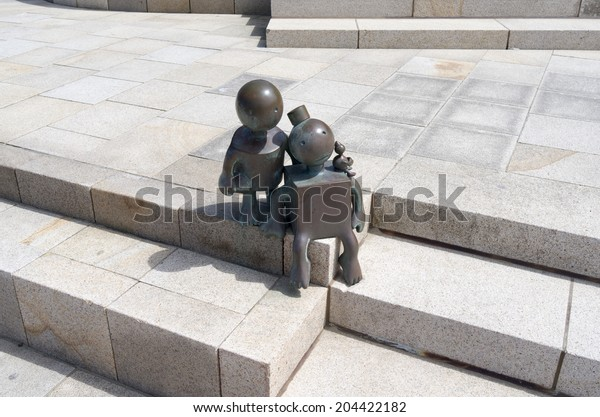 """THE HAGUE - NETHERLANDS - CIRCA JUNE 2014: Sculpture garden, with sculptures from the American Tom Otterness on the boulevard in Scheveningen called """"Fairytale Sculptures by the Sea""""."""