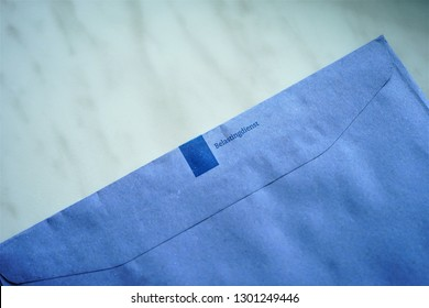 The Hague, The Netherlands - February 1, 2019: Official blue envelope of the Dutch Tax Authorities (Dutch: Belastingdienst)