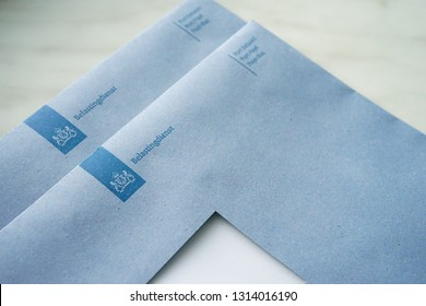 The Hague, The Netherlands - February 15, 2019: Official blue envelopes of the Dutch Tax Authorities (Dutch: Belastingdienst)