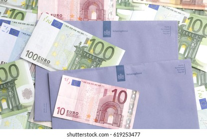 The Hague, The Netherlands - February 20, 2014: Blue envelope of the dutch tax office with euro notes on top