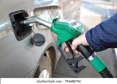 The Hague, The Netherlands - January 12, 2013: Man is filling his car with petrol at a gasstation