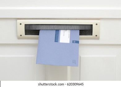 The Hague, The Netherlands - January 20, 2015: Blue envelopes of the dutch tax office in the mailbox
