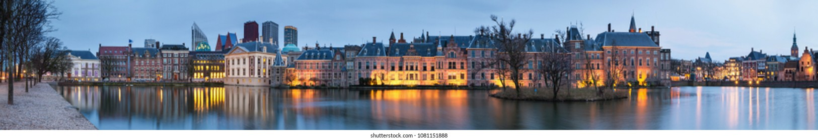 The Hague, Netherlands, January 6, 2018. City Landscape, sunset panorama - view on pond Hofvijver and complex of buildings Binnenhof in from the city centre of The Hague, Netherlands