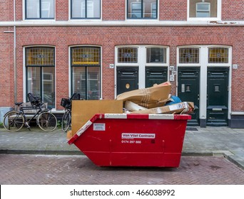 The Hague, the Netherlands - July 04, 2016: rubbish skip full of cardboard
