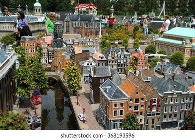 THE HAGUE, THE NETHERLANDS, July 5, 2012: Tourists are wandering around in Madurodam, a miniature park with scale model replicas of Dutch buildings and a  popular tourist attraction in the Netherlands