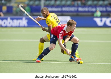 THE HAGUE, NETHERLANDS - JUNE 2: England Defender Hoare (in posession of the ball) turns away from Indian Attacker Sunil during the World Cup Hockey. England beats India 2-1