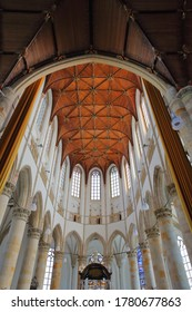 THE HAGUE, NETHERLANDS - JUNE 20, 2020: The interior of Grote of Sint Jacobskerk (an historic church with an iconic tower), with a wooden vaulted ceiling