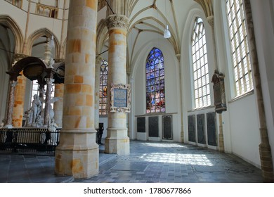 THE HAGUE, NETHERLANDS - JUNE 20, 2020: The interior of Grote of Sint Jacobskerk (an historic church with an iconic tower), with columns and stained glasses, and the monument to Wassenaer Obdam