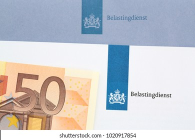 The Hague, The Netherlands - June 23, 2015: Blue envelope of the dutch tax office with a fifty euro note