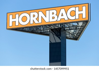 THE HAGUE, THE NETHERLANDS - JUNE 29, 2019: Hornbach sign against blue sky. Hornbach is a German DIY-store chain offering home improvement and do-it-yourself goods.