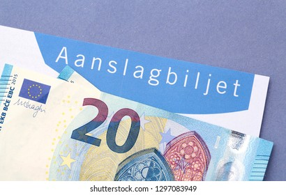 The Hague, The Netherlands - March 1, 2016: A tax demand form, in dutch aanslagbiljet, with twenty euro notes on a blue envelope of the Dutch Tax Authority