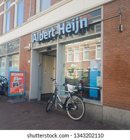 The Hague, Netherlands - March 19, 2018: Entrance of an Albert Heijn store in The Hague, the largest supermarket in The Netherlands